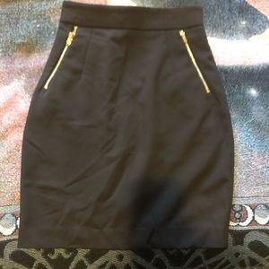 Black pencil skirt with gold zippers
